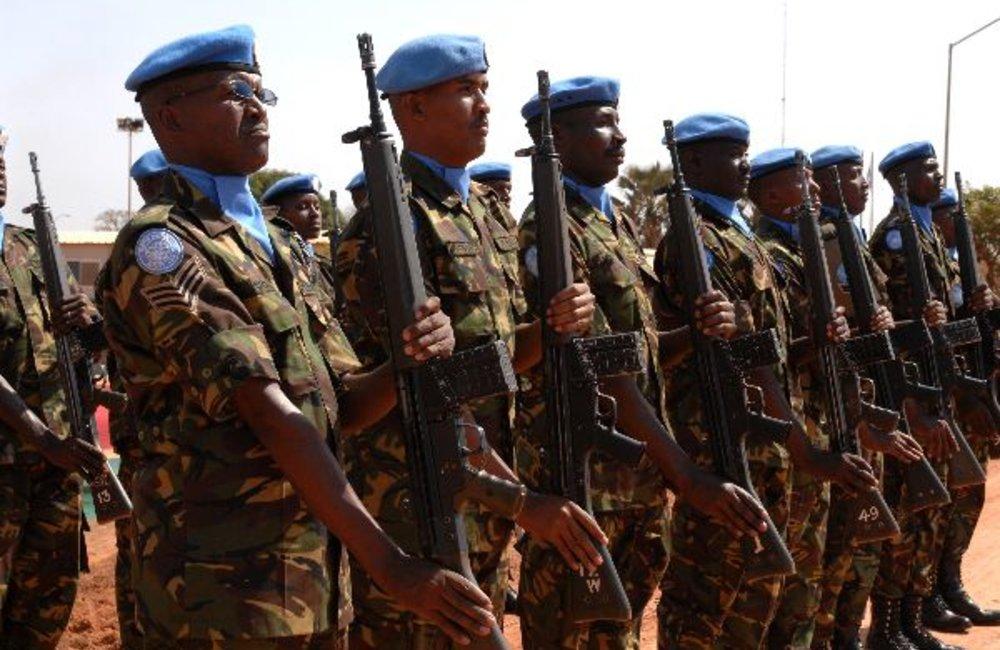 Reviewing a Kenyan contingent guard of honour.